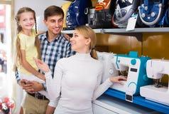 Family buying sewing machine Stock Image