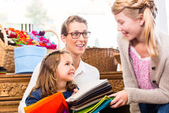 Family buying supplies in handicraft store Royalty Free Stock Photography