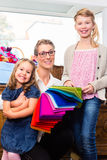 Family buying supplies in store Royalty Free Stock Image