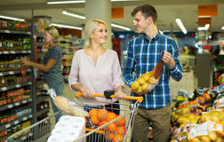 Family  buying sweet fruits Royalty Free Stock Photography