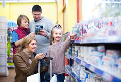 Family buying tooth-brush in supermarket Stock Photos
