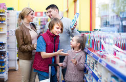 Family buying tooth-brush in supermarket Stock Photography