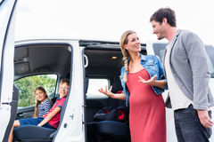 Family buying van at car dealer on the yard Royalty Free Stock Photo