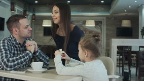 Family In Cafe. Father and daughter meeting mother. stock footage