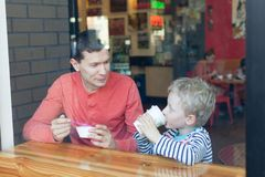 Family in cafe. Family of two enjoying their day together in cafe Stock Photo
