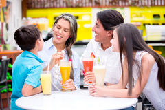 Family at a cafeteria Royalty Free Stock Photo