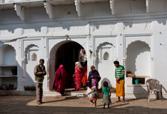 Family came inside the yard of historical hindu temple Royalty Free Stock Image