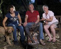 Family at campfire Royalty Free Stock Photography