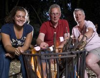 Family at campfire Royalty Free Stock Images