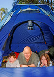 Family Camping. Father and children camping in tent stock photos