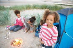 Family Camping On Beach And Toasting Marshmallows Stock Image