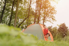 Family camping. Chinese happy mother and son camping in field with trees background stock images