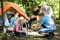 Family camping in the forest royalty free stock image