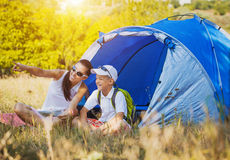 Family camping in the park Stock Images