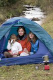 Family camping in tent. Mother and daughters camping in tent stock images