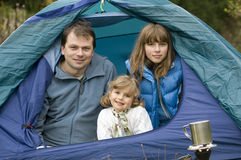 Family camping in tent Stock Photography