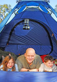 Family Camping in Tent. Family having fun in tent outdoors stock photo
