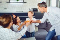 A family with a candle cake celebrates a birthday party. royalty free stock photos