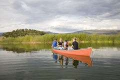 Family and canoe. A family in a canoe on a pond fishing Royalty Free Stock Photography