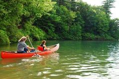 Family Canoe. A Family Paddles on Walden Pond, Massachusetts stock image