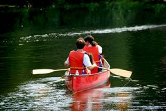 Family canoe river stock images