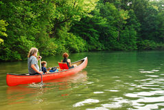 Family Canoe. A family takes to a canoe on Walden Pond in Massachusetts Royalty Free Stock Photos