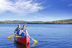 Family canoe trip. Father and daughter canoeing on Lake of Two Rivers, Ontario, Canada stock photography