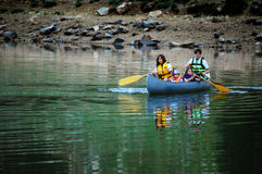 Family Canoeing at Lake Stock Image