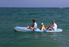 Family canoeing in the sea. Royalty Free Stock Images