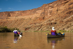 Family in canoes on desert river Stock Image