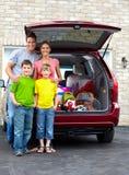 Family car. Smiling happy family and a family car Royalty Free Stock Photos