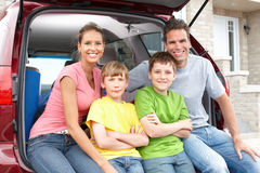Family car. Smiling happy family and a family car Royalty Free Stock Photography