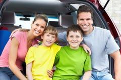 Family car. Smiling happy family and a family car Stock Photos