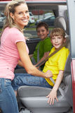 Family car. Smiling happy family and a family car Royalty Free Stock Photo