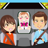 Family Car. Happy family sitting inside car driving through a road with seatbelts fastened Stock Photo
