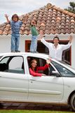 Family with a car Stock Photography