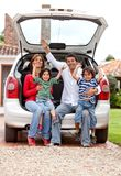 Family with a car Royalty Free Stock Photos