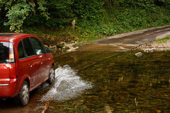 Family car crossing a river at ford Royalty Free Stock Photo