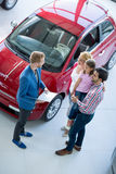 Family with car dealer Royalty Free Stock Photo