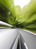 Family car driving. Motion blur shot of a car driving in a curve Stock Photography