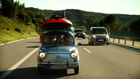 Family car filled with stuff on the road toward summer holidays stock footage