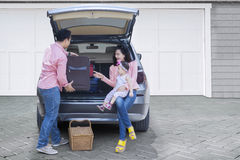 Family with car prepare for vacation Stock Photos