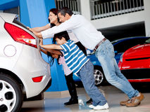 Family with car problems Royalty Free Stock Image
