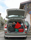 Family car ready to go with the trunk full of suitcases Stock Photos