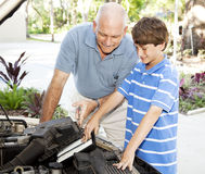 Family Car Repairs Royalty Free Stock Photos