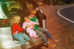 Family car travel - happy kids on the road. In nature Stock Photos