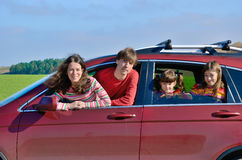 Family car travel on vacation, parents and kids have fun, insurance concept Stock Image