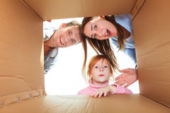 Family in a cardboard box ready for moving house Stock Images