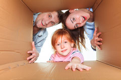 Family in a cardboard box ready for moving house Royalty Free Stock Images