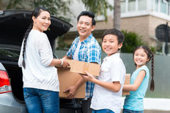 Family with cardboard boxes Stock Image